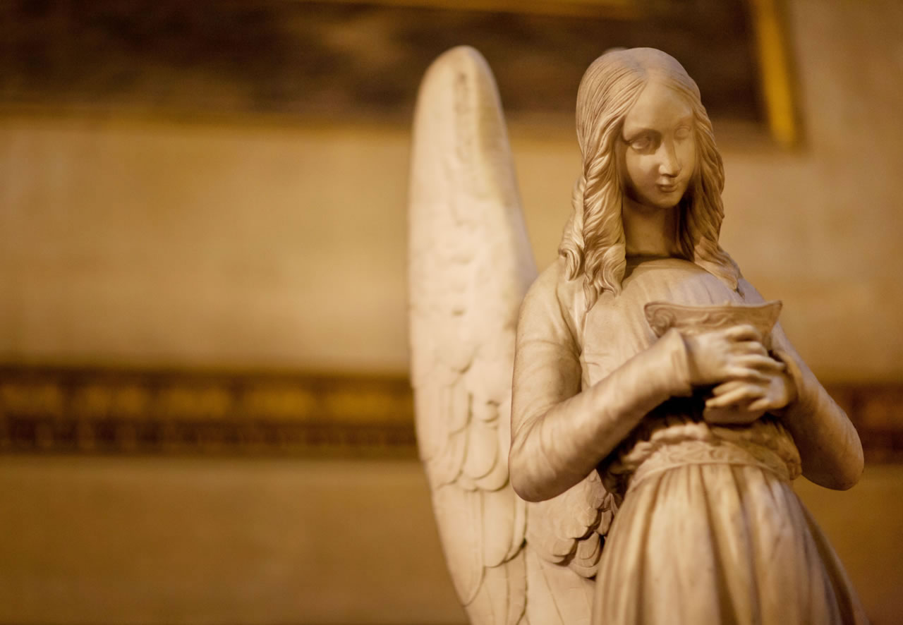 Angel statue in European cathedral - Ginger Wagoner, Photographer, Photosynthesis