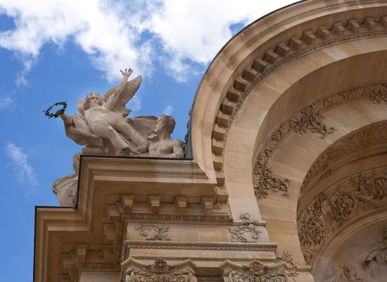 Angel statue atop museum in Paris - Ginger Wagoner, Photographer, Photosynthesis