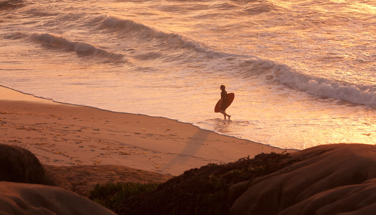 Surfer on the beach - Ginger Wagoner, Photographer, Photosynthesis