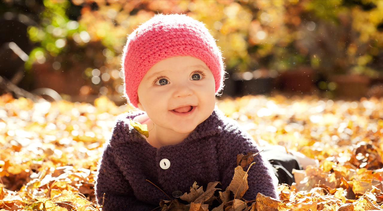 Artistic portrait of baby in hat and leaves - Ginger Wagoner, Photographer, Photosynthesis