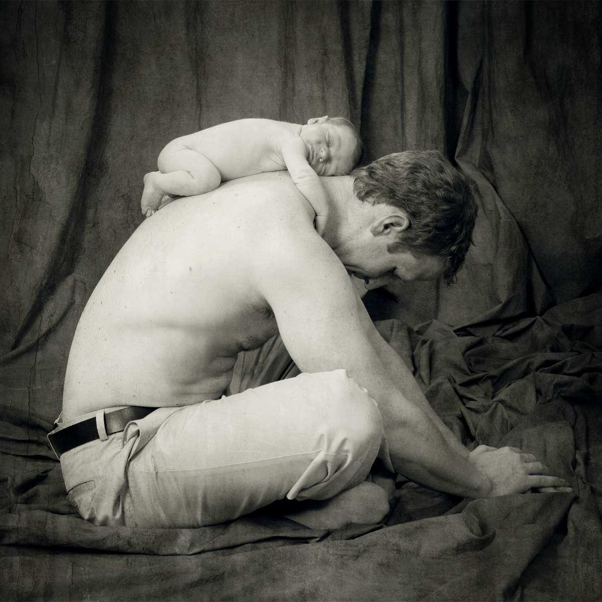 Newborn on Dad's back - Ginger Wagoner, Photographer, Photosynthesis