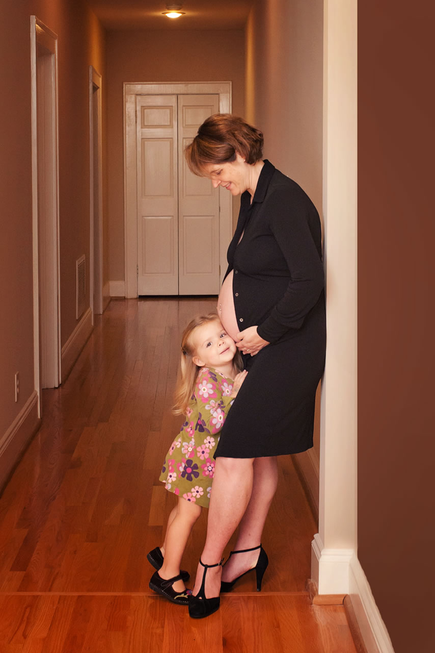 Artistic portrait of little girl with pregnant, maternity mom standing and showing belly - Ginger Wagoner, Photographer, Photosynthesis