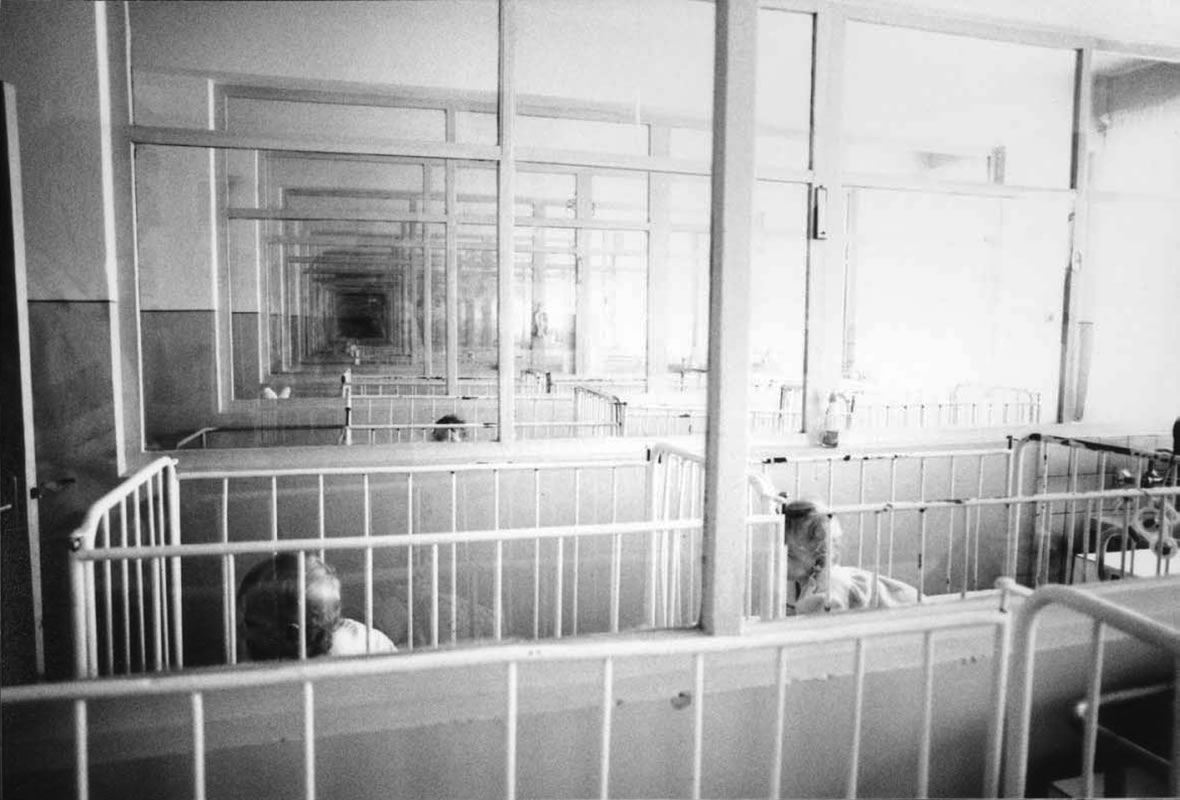 Rows of rooms and cribs at orphanage in Romania - Ginger Wagoner, Photographer, Photosynthesis