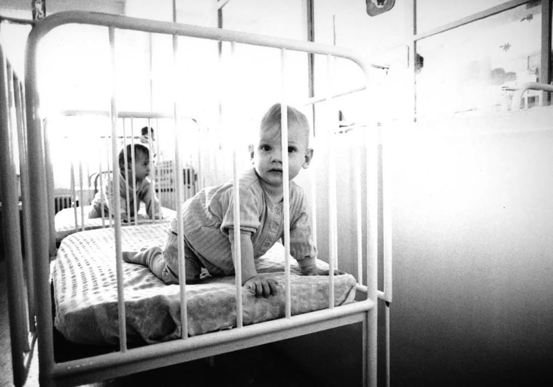 Orphans in cribs at orphanage in Romania - Ginger Wagoner, Photographer, Photosynthesis